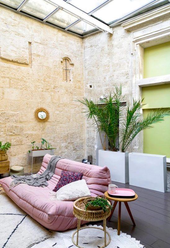 A pink Togo sofa