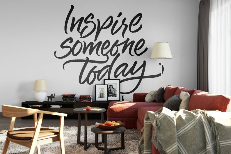 XXL letters on the wall saying INSPIRE SOMEONE TODAY